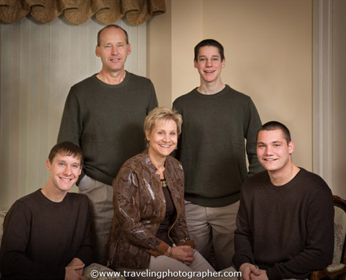 Family portrait on Mom, Dad, and three sons at home in the living room